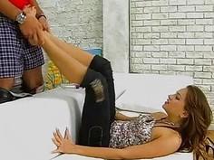 Hot brunette gives a great footjob