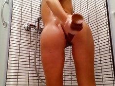 Blonde masturbating in the shower