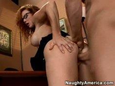Horny red head girl Audrey Hollander rides man on the office desk
