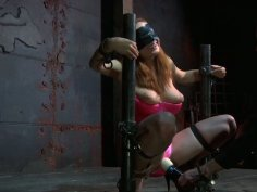 Slutty redhead Ashley Graham is pleasured with vibrator in a BDSM video