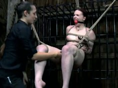 Immobilized Claire Adams undergoes the rough BDSM treatment