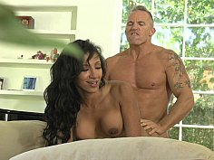 Dark-haired MILF drilled on a couch