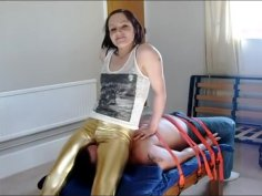 facesitting in gold leggings.