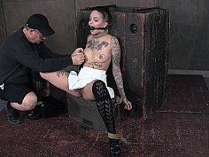 Gagged chick with tats fucked with toys