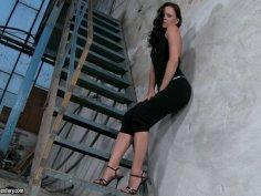 Tight brunette girlie Jo stripteases over the steps