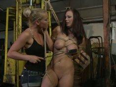 Kathia Nobili ties up bosomy brunette Zyna Babe and spanks her