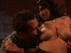 Wild brunette Kitty Bella gives blowjob in the most bizarre place