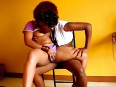 Wild African lesbians Jojo and Akua strip and fuck on bed