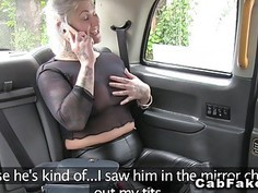 Blonde in see through shirt in fake taxi
