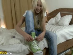 Blond Russian slut takes off her clothes in front of camera